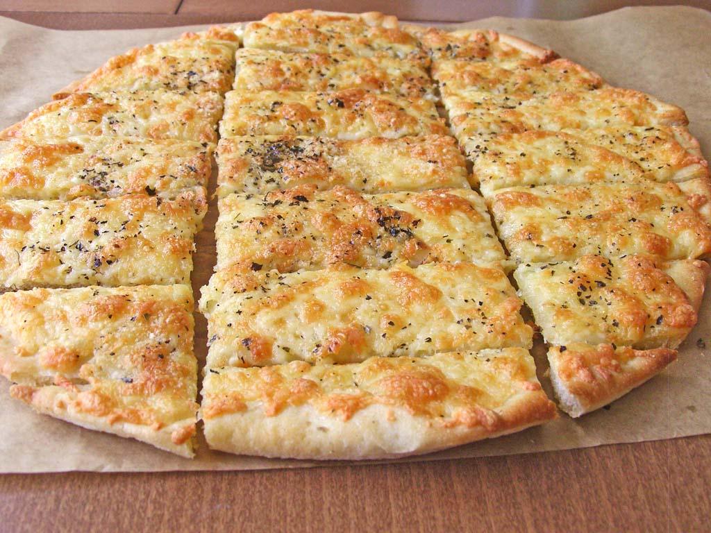 Easy Cheesy Garlic Breadsticks - Sugar Apron