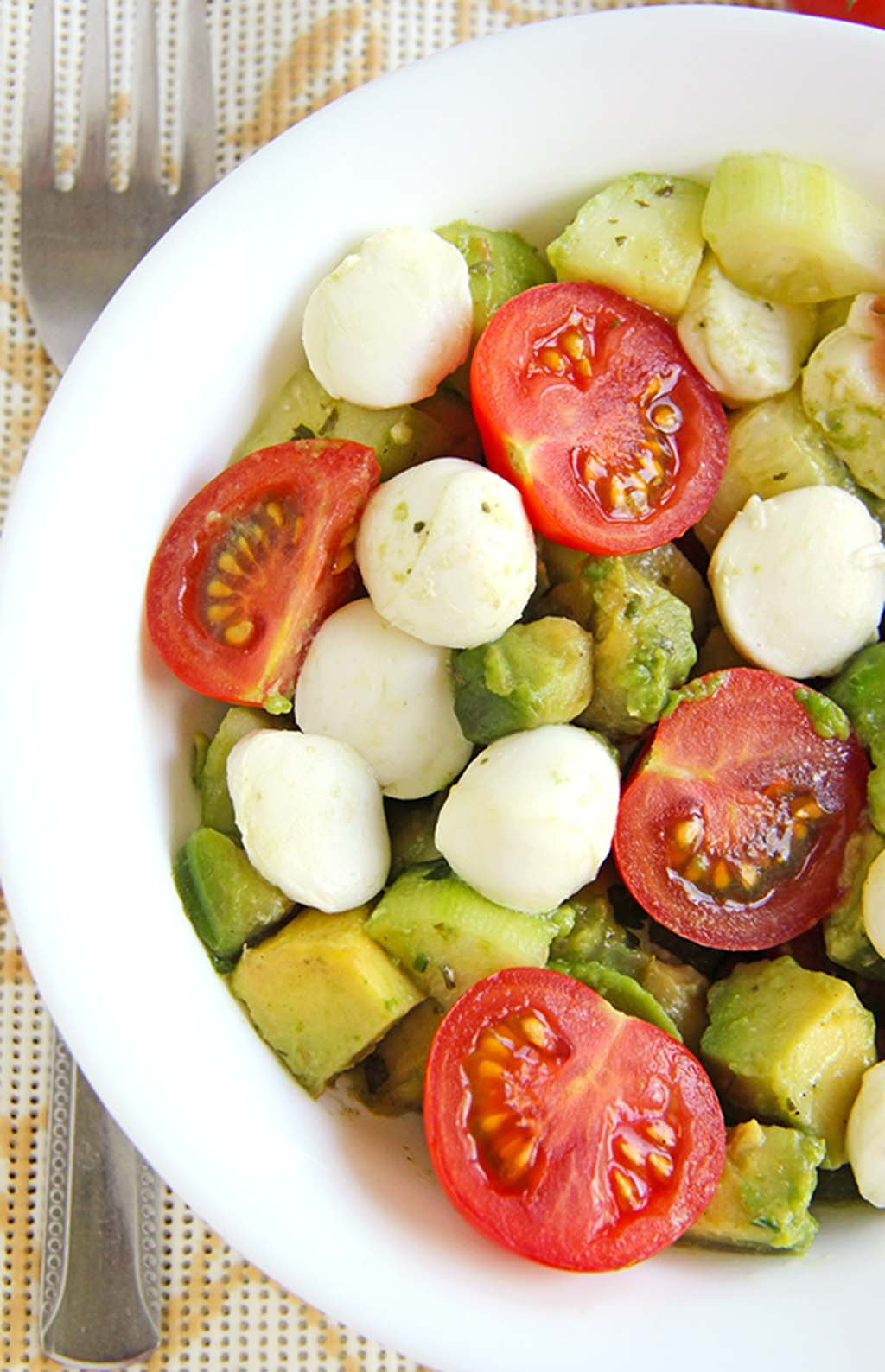 Avocado Salad with Tomato, Cucumber and Mozzarella served with some crunchy french bread and you've got a cool, easy dinner for a hot day.