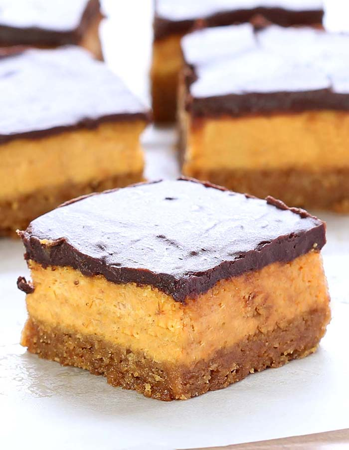These bars are creamy, chocolate-ly, packed with pumpkin and cream cheese. #popular