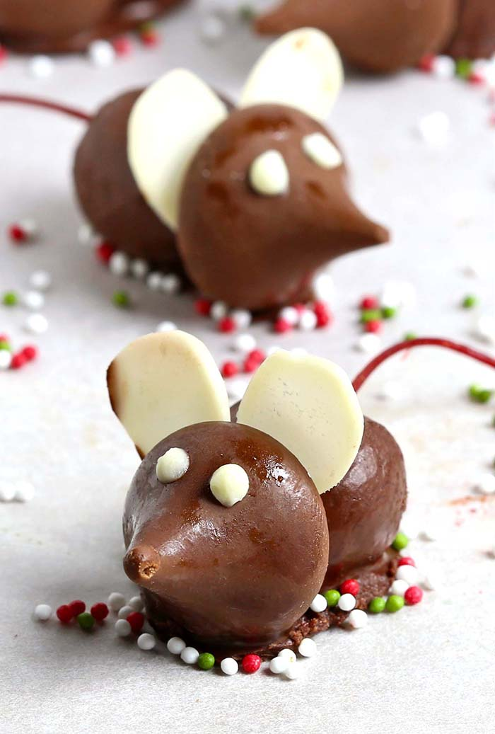 These fun Chocolate Cherry Christmas Mice made from chocolate covered cherries with almond slices and Hershey's Kisses, are a great addition to your Christmas table.