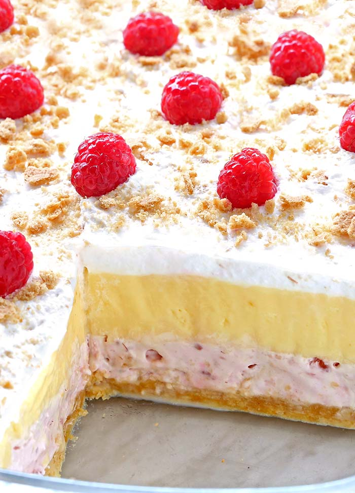 """Creaminess"", ""coolness"", ""tartness"", ""sweetness"" — these are powerful words to describe the taste of No Bake Raspberry Cheesecake Lasagna."