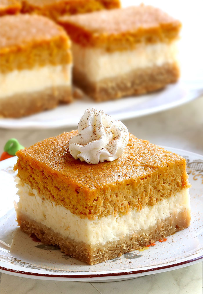 Pumpkin Pie Cheesecake Bars are everything you love about spiced pumpkin pie and tangy cheesecake, just packed into one sweet dessert. And let me tell you.....they're absolutely delicious!!
