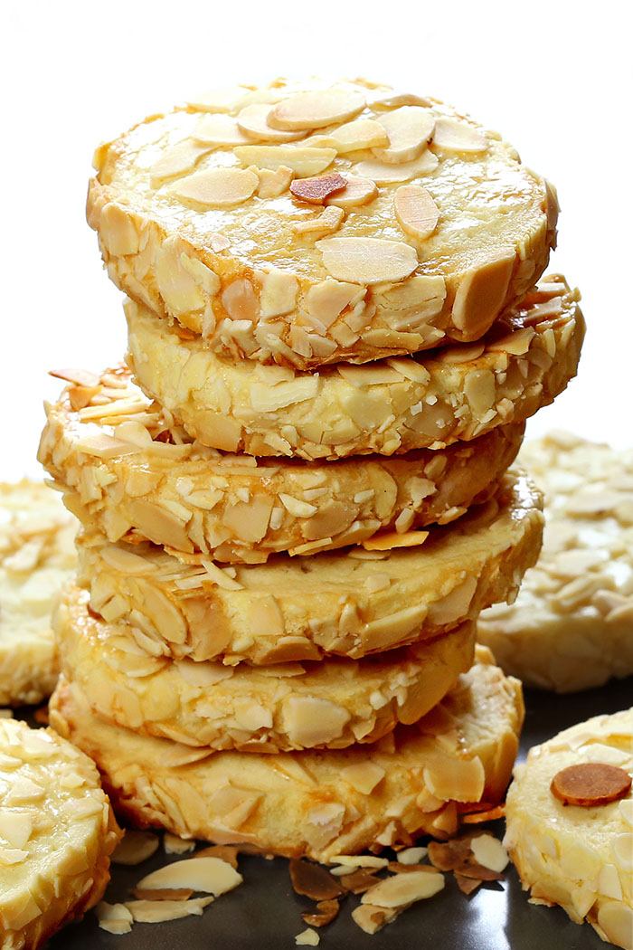 Buttery melt-in-your-mouth sugar cookies with the tang of cream cheese and garnished with slivered almonds.
