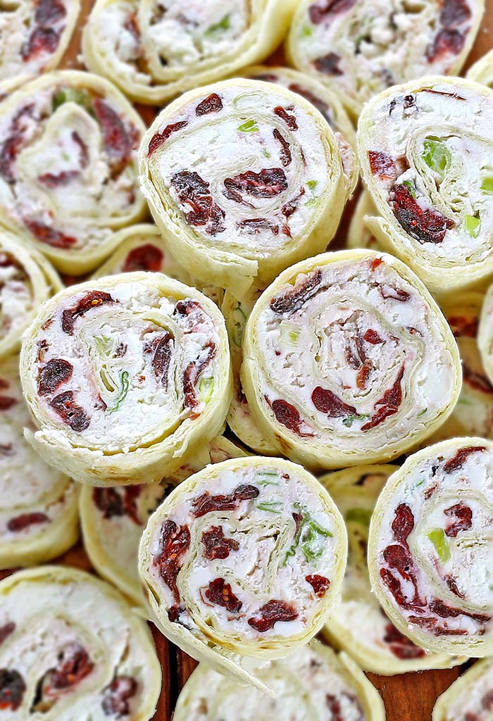 Festive red, green, and white - Cranberry Feta Tortilla Roll Ups are a absolute must make for Christmas or New Year's Eve get together.