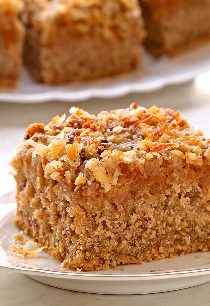 Classic Oatmeal Cake is an soft, delicately spiced old-fashioned cake made with rolled oats and a delicious caramelized coconut pecan topping.