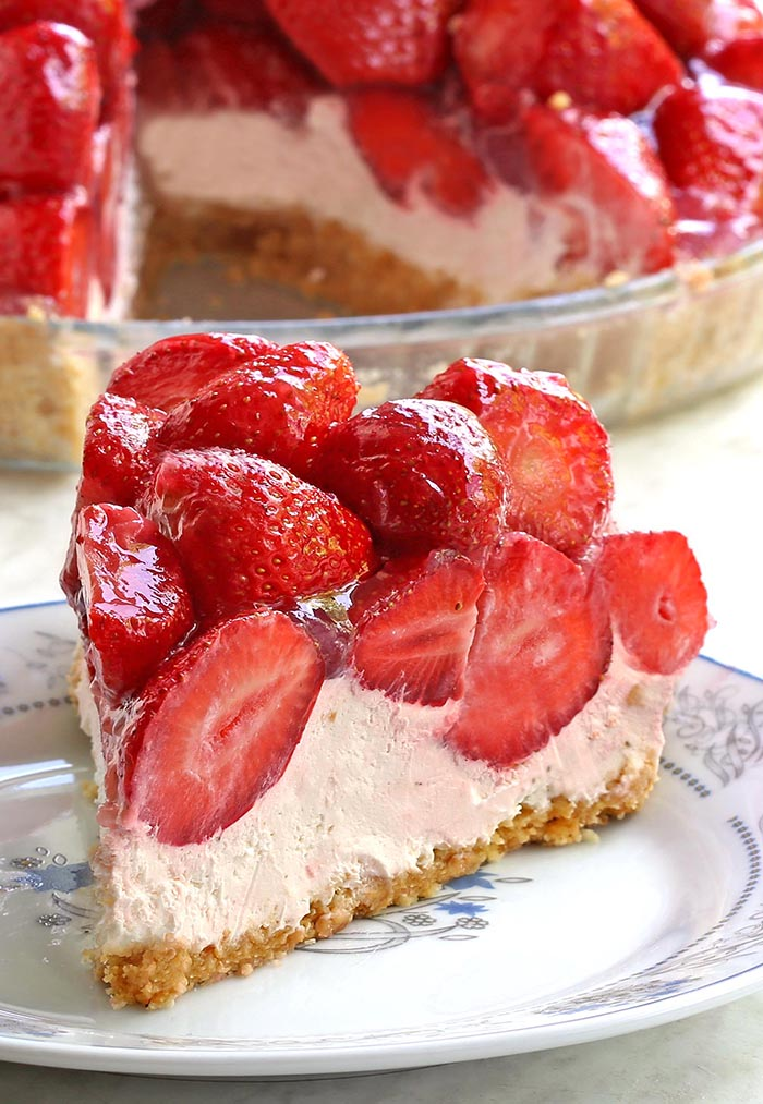No Bake Strawberry Cream Cheese Pie is The BEST STRAWBERRY PIE you will ever have! Made with a graham cracker crust, filled with lemony cream cheese layer and topped with a mountain of juicy fresh strawberries.