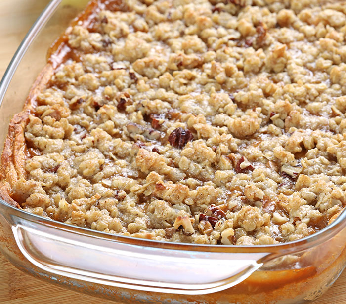 Caramel Apple Pie Bars are the perfect dessert: a Crescent dough crust with tender, warmly spiced, caramel-flavored apples and nutty crumble topping.