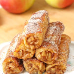Apple Pie French Toast Roll Ups - Perfect grab-and-go breakfast or snack. Tasty apple pie filling rolled inside the slice of bread, fried until golden brown and coated with cinnamon-sugar